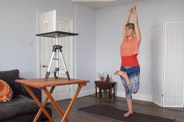 stephanie doing a group yoga class online